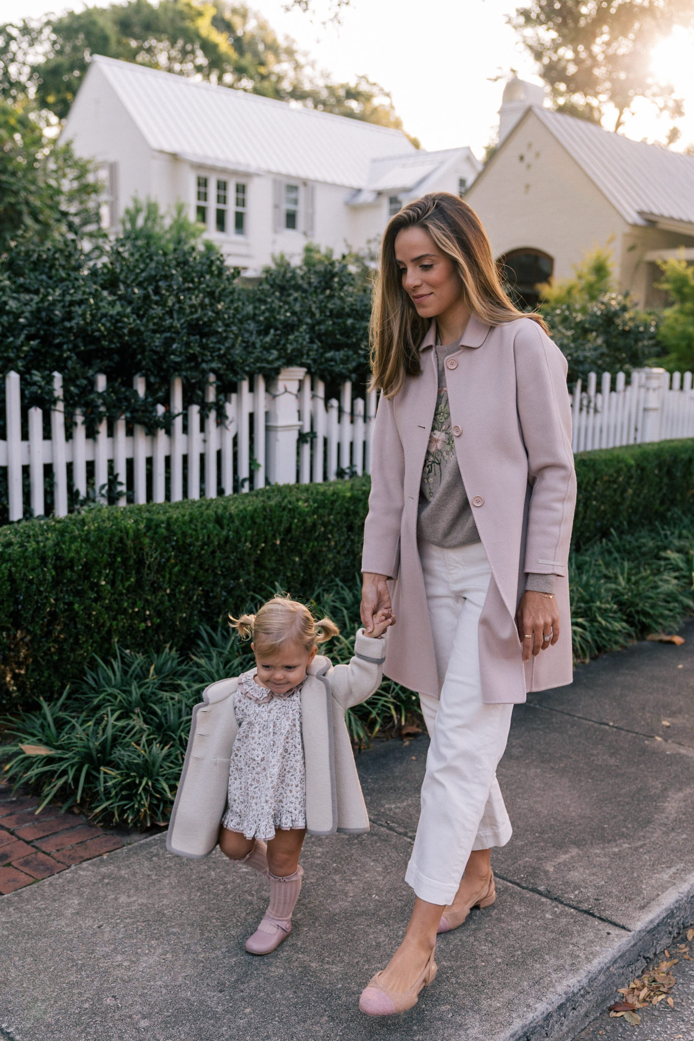 blush coat floral sweater white pants
