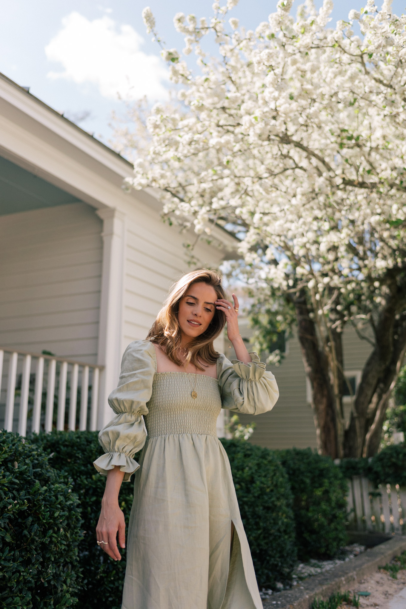 green linen smocked long sleeve dress