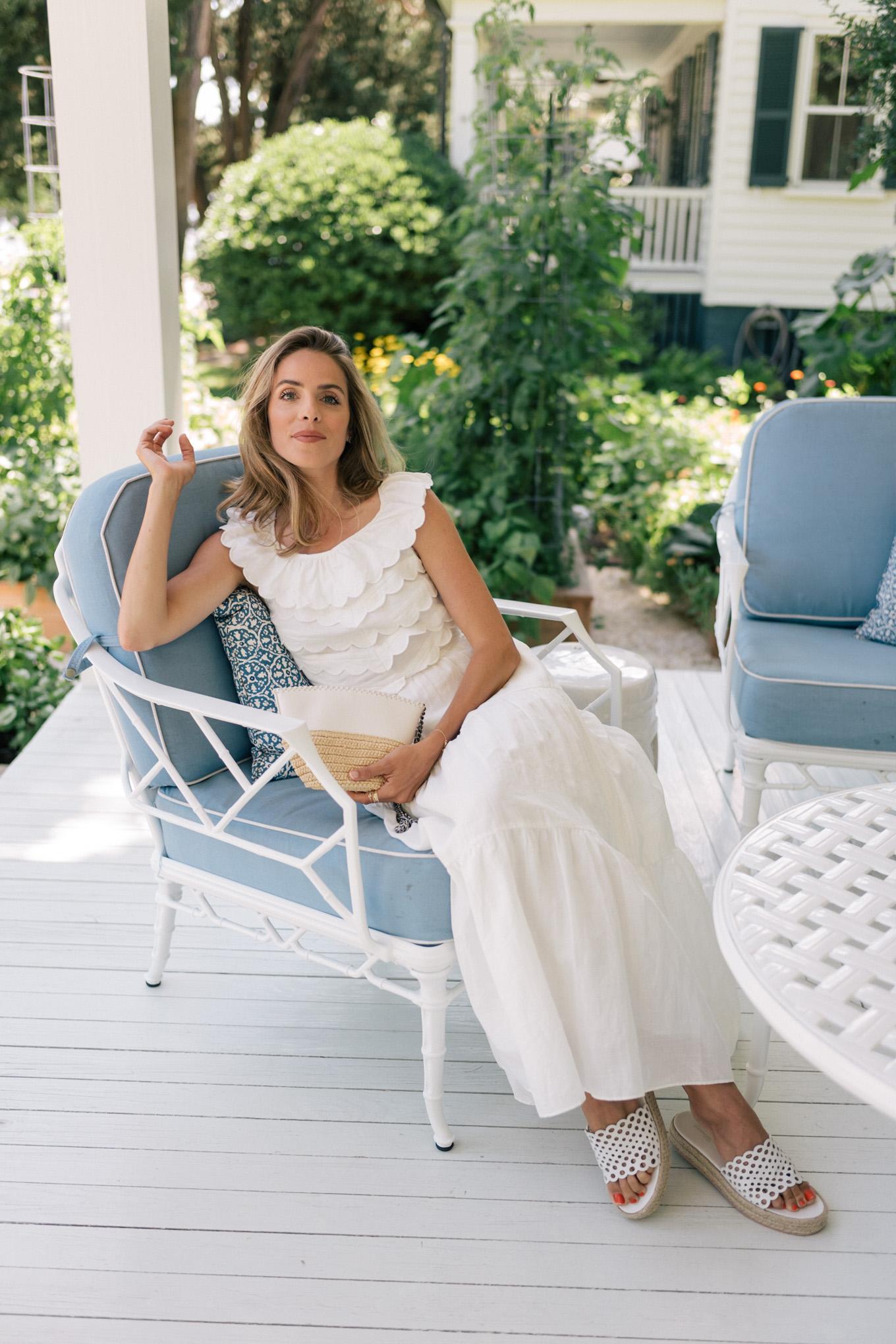 white sleeveless ruffle midi dress